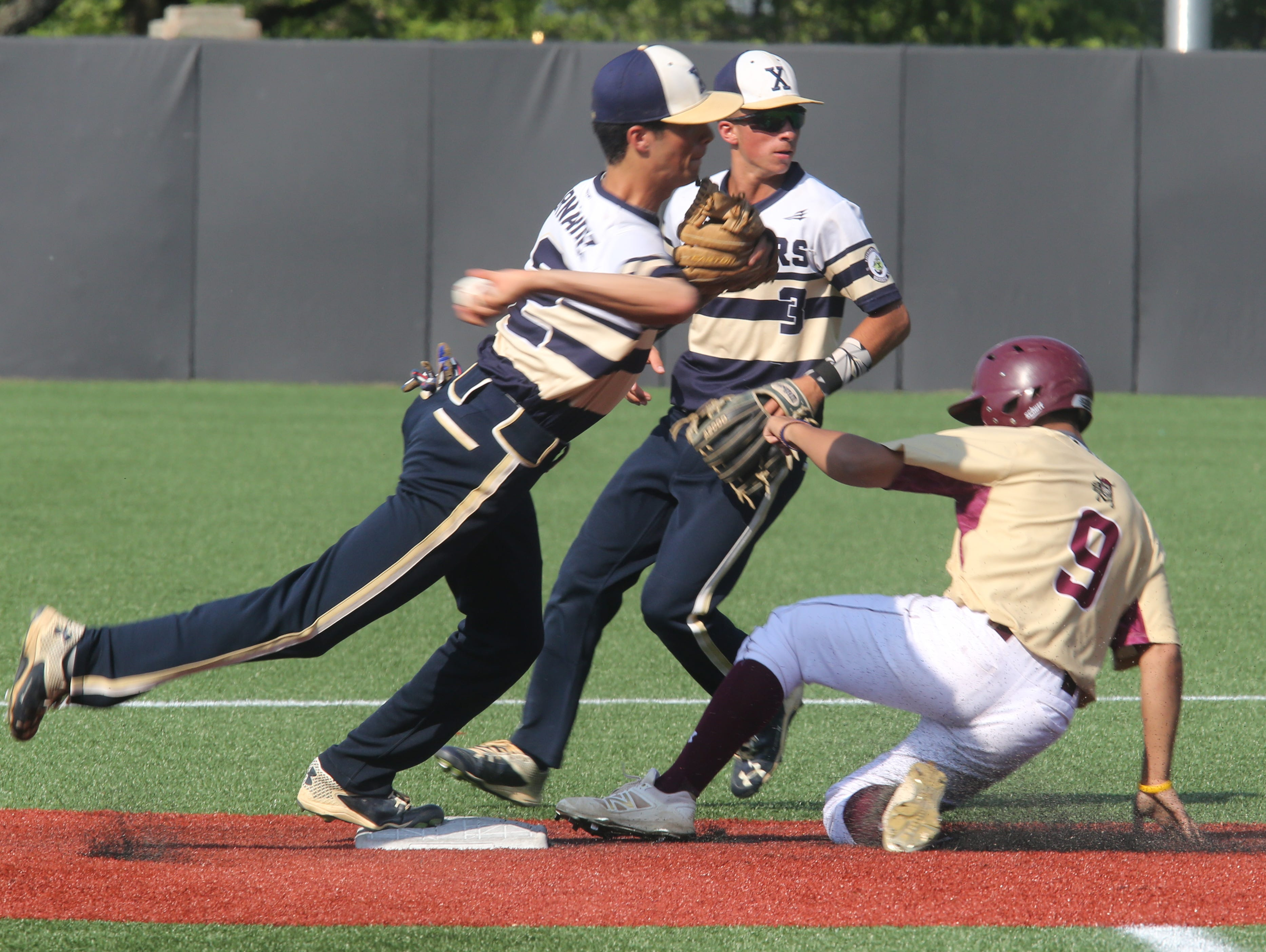 Iona Prep's Domenico Bruzzese (9) is tagged out on second during CHSAA baseball playoffs at Fordham University in Bronx on June 1, 2016. Iona Prep defeats Xaverian 4-0.