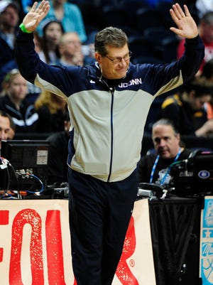 Connecticut coach Geno Auriemma with his team during practice Saturday for the NCAA Women's Final Four at Bridgestone Arena.