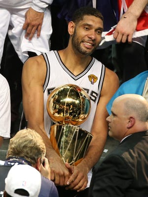 Spurs forward Tim Duncan holds the Larry O'Brien Trophy, the fifth he's won in 17 seasons, after Game 5 of the NBA Finals on Sunday night.
