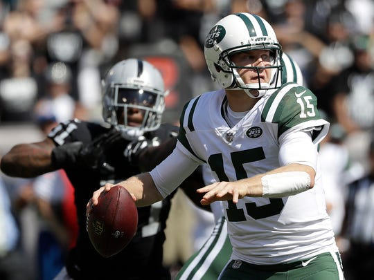 New York Jets quarterback Josh McCown (15) passes against the Oakland Raiders during the first half of an NFL football game in Oakland, Calif., Sunday, Sept. 17, 2017.