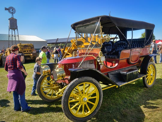 Visitors to Albany Pioneer Days look over a rare 1910