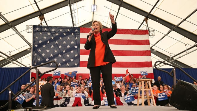 Hillary Clinton takes to the stage at a rally held for her at the Central New York Regional Market during her campaign swing through Syracuse Friday, April 1.