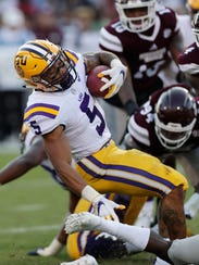 LSU running back Derrius Guice (5) is tackled by Mississippi