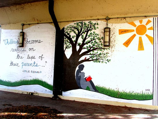 A mural painted under the railroad viaduct on Water