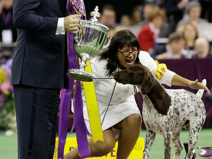 Valerie Nunes-Atkinson reacts after CJ, a German shorthaired