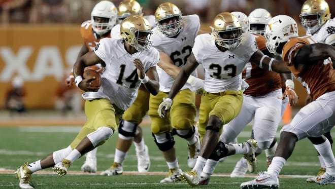 Notre Dame quarterback DeShone Kizer (14) runs for a first down against Texas during the first half of an NCAA college football game, Sunday, Sept. 4, 2016, in Austin, Texas. (AP Photo/Eric Gay)