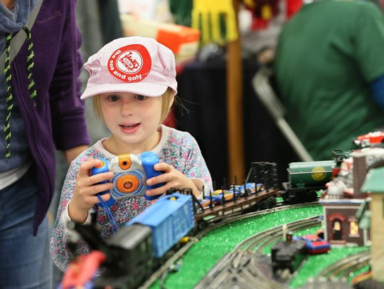 Kira Klein of Brookfield enjoys the 2016 Trainfest. The 2017 edition of what's billed as America's largest operating model railroad show runs this weekend at Wisconsin State Fair Park.