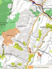 The recent purchase of 2,085 acres in Duxbury (in orange) by The Trust for Public Lands expands the size of Camels Hump State Park.
