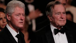 Bill Clinton and George H.W. Bush attend a performance