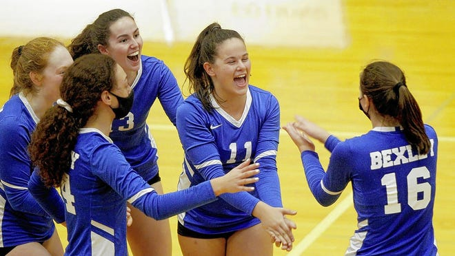 Madison Lampke (11) and Kate Hueffner (16) celebrate a point during the Bexley girls volleyball team's game against CSG on Sept. 16.