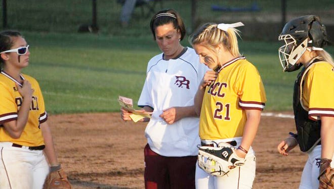 Pearl River Community College softball coach Leigh White talks with sophomore pitcher Jackie Shows during the Wildcats' game against Mississippi Gulf Coast Wednesday at Poplarville.