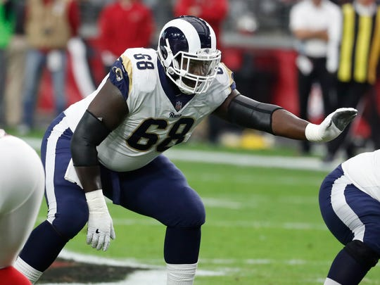 FILE - In this Dec. 3, 2017, file photo, Los Angeles Rams offensive guard Jamon Brown (68) gets ready for a play during the first half of the team's NFL football game against the Arizona Cardinals in Glendale, Ariz. Brown is back with the Rams' offensive line after a two-game suspension for violating the NFL's substances of abuse policy. If Brown isn't in the starting lineup when the Rams  host the Chargers on Sunday, Sept. 23, the right guard doesn't sound overly disappointed about the decision. Brown knows just how well Austin Blythe played in his unfortunate absence. (AP Photo/Rick Scuteri, File)