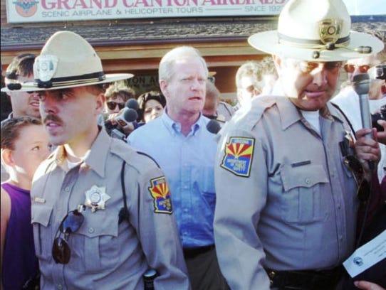 Arizona Gov. Fife Symington, led by Department of Public