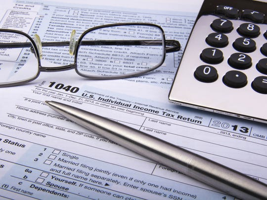 ecba5bfde89 Tax form (Photo  Thinkstock). Benjamin Franklin was correct  The two sure  things ...