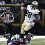 Saints running back C.J. Spiller breaks free from Dallas safety Barry Church on the way to scoring the winning touchdown in overtime Sunday night in New Orleans.