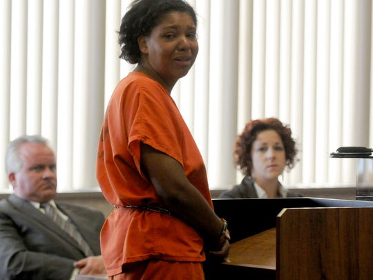 Tia Skinner looks to her family and addresses them Thursday, July 11, 2013 during her first resentencing.