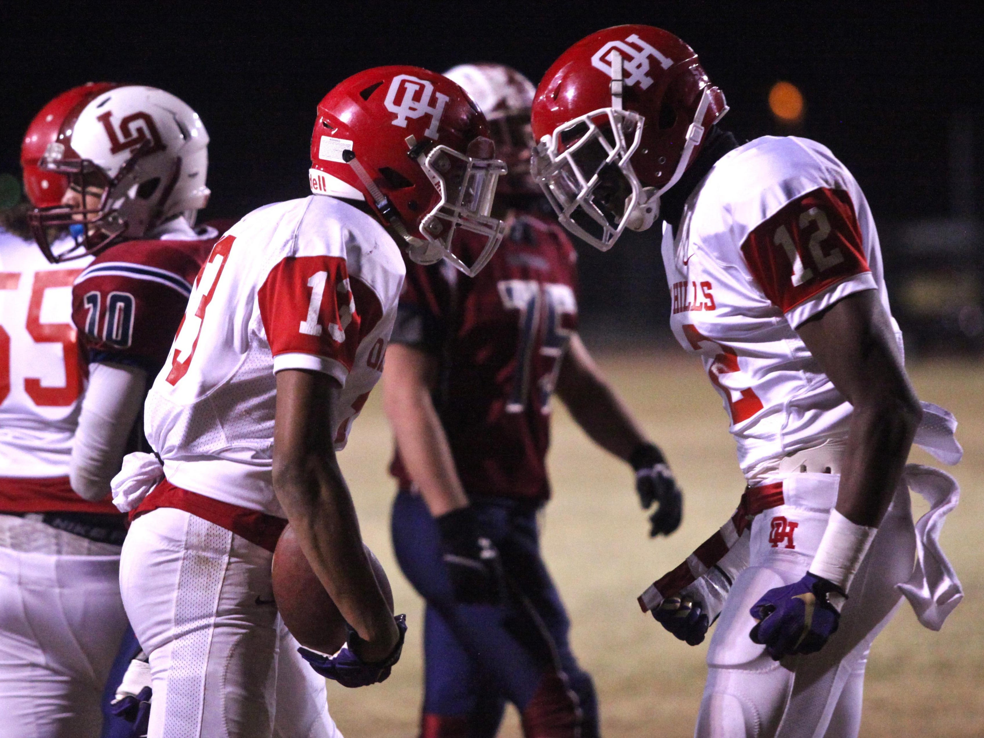 The Oak Hills Bulldogs celebrate a touchdown during the CIF semifinal with the La Quinta Blackhawks on Friday. The Bulldogs defeated the Blackhawks by a score of 33-21.