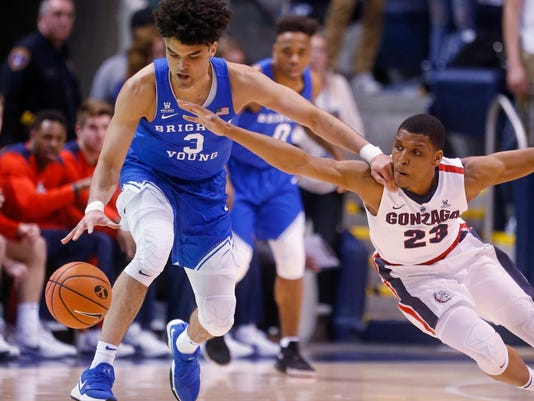 Gonzaga guard Zach Norvell Jr. (23) battles for a loose ball with BYU guard Elijah Bryant (3) in the first half of an NCAA college basketball game Saturday, Feb. 24, 2018, in Provo, Utah. (AP Photo/Rick Bowmer)