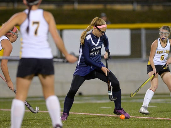 New Oxford's Kaelyn Long, center, works to drive the ball against Red Lion's McKayla Colley, Lauren Sieling and Samantha Collis in the first half of a YAIAA Division I field hockey game Thursday, Oct. 15, 2015, at Red Lion. Red Lion defeated New Oxford 2-1. Chris Dunn Ñ Daily Record/Sunday News