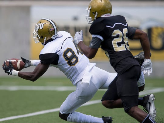 Wallace Corker (84) makes a diving catch during the Alabama State University Black and Gold Game at Hornet Stadium on the ASU campus in Montgomery, Ala. on Saturday April 28, 2018.
