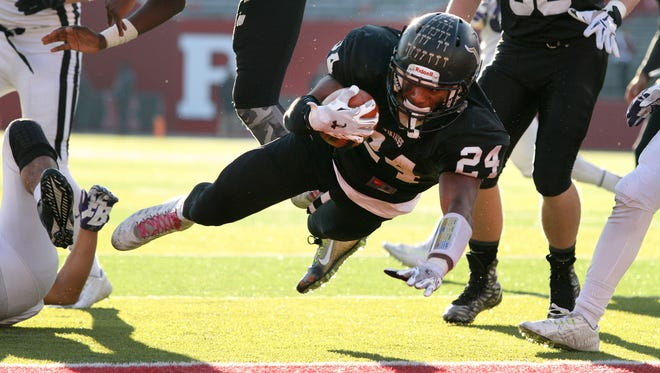 South Brunswick's #24 Phil Campbell dives into the end zone for a touchdown during the second half of the game. South Brunswick defeated Old Bridge in the Central Group V football championship, Piscataway, NJ, December 5, 2015. Mary Iuvone/For The Home News