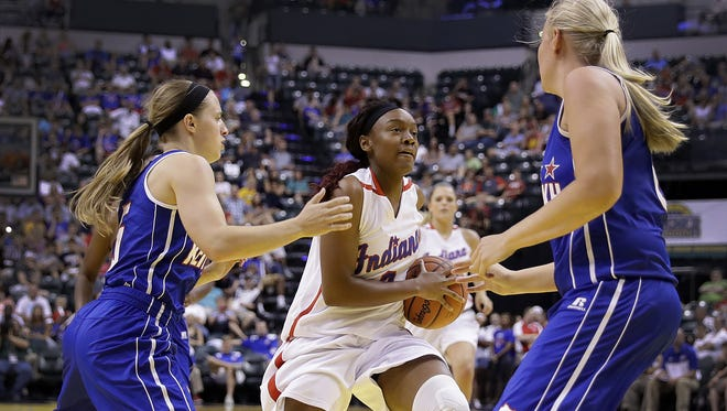 IndianaÕs Jayla Scaife (2) drives between KentuckyÕs Whitney Creech (5) and Sarah Price (8) in the second half of their All-Stars game Saturday, June 11, 2016, evening at Bankers Life Fieldhouse. The Indiana All-Stars defeated the Kentucky All-Stars 106-69.  5 2 8
