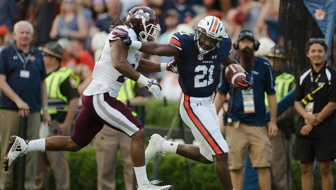 Auburn running back Kerryon Johnson (21) is run out of bounds by Mississippi State defensive back Chris Rayford (24) during the NCAA football game between Auburn and Mississippi State on Saturday, Sept. 30, 2017 in Auburn, Ala.