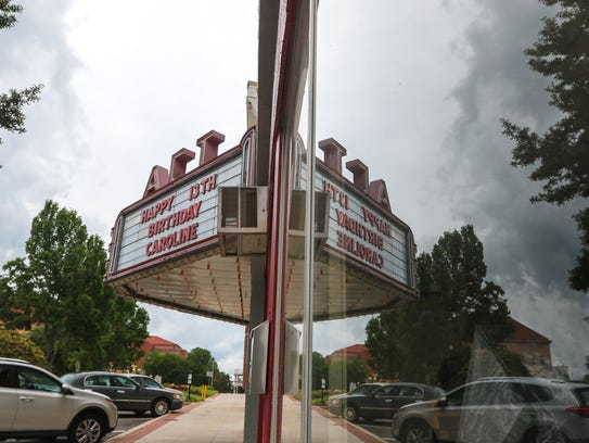 The Alverson Center Theatre marquee sign reflects in