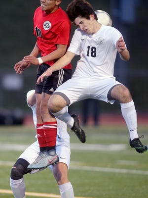 Central Kitsap soccer player Josh Roche goes up for the ball with Shelton's Jesus Flores-DeSantiago at Silverdale Stadium on Thursday night.
