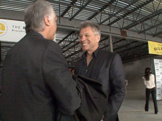 Jon Bon Jovi, Board Chairman of the JBJ Soul Fondation, is interviewed inside the space along Hooper Avenue in Toms River, NJ, Tuesday, April 14, 2015, that will become the BEAT Center.
