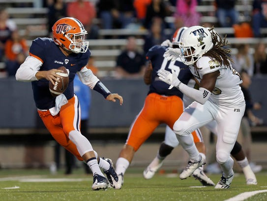 UTEP quarterback Zack Greenlee is chased out of the