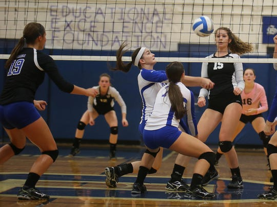 Salem's Lauren Wylie and Sara Soltis (No. 7) work to bump the ball over the net Tuesday night. At left for the Rocks is Drew Smiley. Waiting for the Wildcats is Lydia Bell (No. 15) and libero Charley Irvin (No. 16).