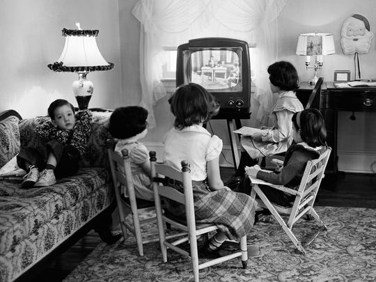In this Jan. 6, 1953, file photo, four children watch