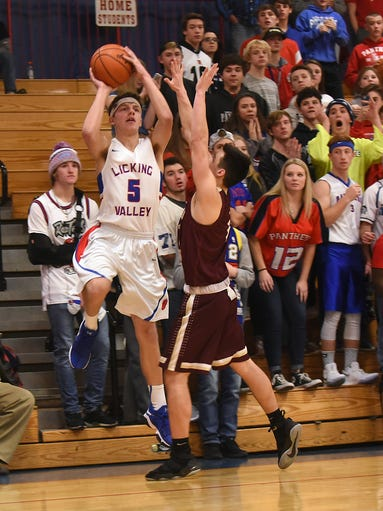 Licking Valley sophomore Carson Conley tries to sink