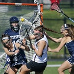 Pittsford's Jillian Quevedo takes control of the ball before Penfield's Megan Motkowski in the first half at Penfield High School.