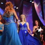Pageant contestant Erin Morgan of Laurel, center, wins an award in the preliminary competition at the 2015 Miss Hospitality Pageant at the Saenger Theater Friday.