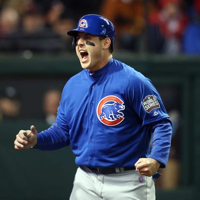 Anthony Rizzo reacts after scoring a run in the fifth
