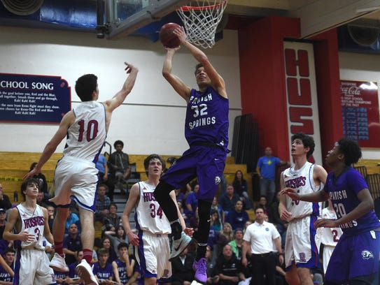 Spanish Springs' Jalen Townsell (32) scores while taking