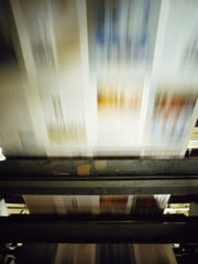 Printed paper on printing press, blurred motion
