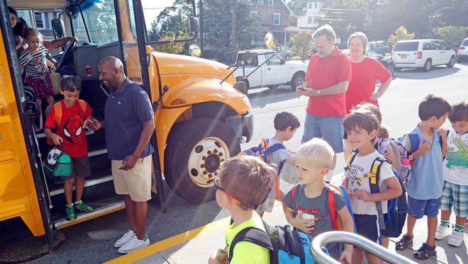 Statistics show many graduates of teacher training programs in New York colleges don't get jobs. But a letter-writer says the numbers don't tell the whole story. Above, students are greeted as they get off the bus on the first day of school at Post Road School, Sept. 3, 2014 in White Plains.