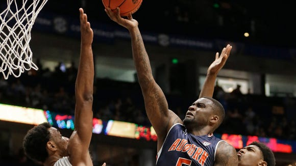 Auburn's Cinmeon Bowers (5) shoots over Tennessee's Derek Reese (23),  Detrick Mostella (15), and Kyle Alexander (11) during the first half of an NCAA college basketball game in the Southeastern Conference tournament in Nashville, Tenn., Wednesday, March 9, 2016. (AP Photo/Mark Humphrey)