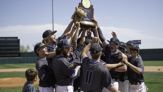 The Pueblo West High School baseball team celebrate with the Class 4A State Baseball Championship trophy after defeating Silver Creek on June 1, 2019 in Colorado Springs Colo.