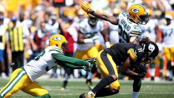 Aug 23, 2015; Pittsburgh, PA, USA; Pittsburgh Steelers wide receiver Markus Wheaton (11) runs after a pass reception as Green Bay Packers free safety Micah Hyde (L) and cornerback Casey Hayward (29) defend during the second quarter at Heinz Field. Mandatory Credit: Charles LeClaire-USA TODAY Sports