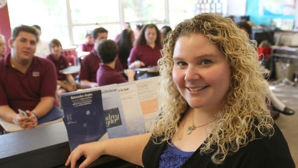 Nadia Rizzo, a chorus teacher at Albertus Magnus High School, poses with her class  Oct. 17, 2014.