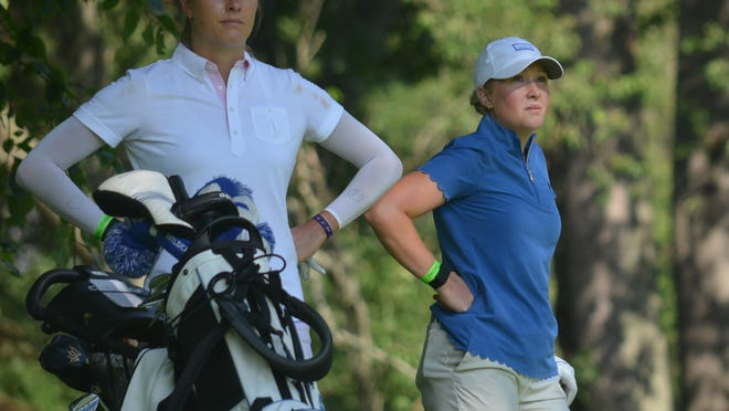 Gabrielle Shipley (left) and sister Sarah Shipley watch a drive on Friday during the opening round of the Symetra Tour's FireKeepers Casino Hotel Championship at the Battle Creek Country Club.