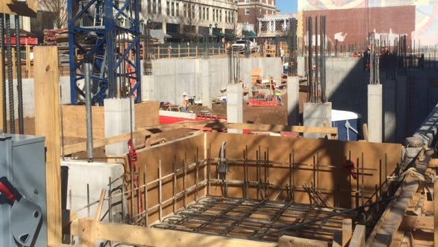 Workers are erecting the foundation of the Cambria Suites Hotel in downtown Asheville, which will have its own parking.