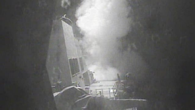 The guided missile destroyer USS Nitze (DDG 94) launches a strike against three coastal radar sites in Houthi-controlled territory on Yemen's Red Sea coast.