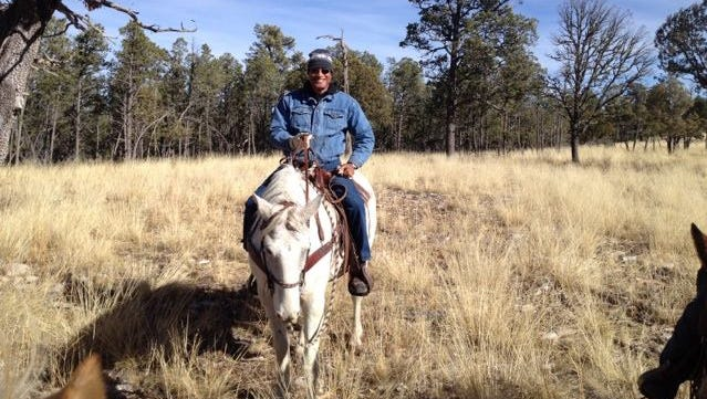 A visitor enjoys a trip on horseback while exploring the Lincoln National Forest.