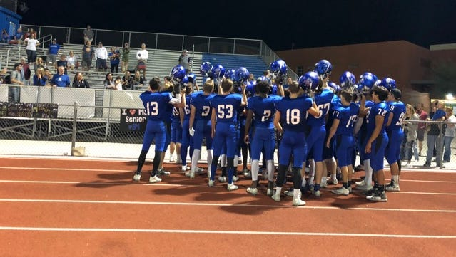 Fountain Hills gathers after their 49-14 win over Valley Christian.