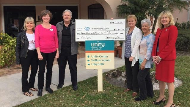 The Vero Vino Wine & Food Festival, held by Unity Center of Vero Beach, recently gave $3,361.85 to the Boys & Girls Clubs of Indian River County. Pictured are, from left, Patti Carlson, Susan Rane, Pastor Dan Holloway, Elizabeth Thomason of Boys & Girls Clubs, Barbara Petrillo and Tammy Bursick.